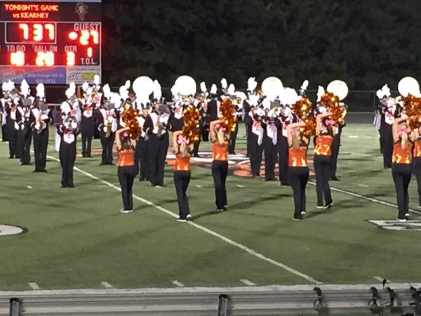 Platte County Dance Team performs at a Friday night football game with the Platte Co Traditions band