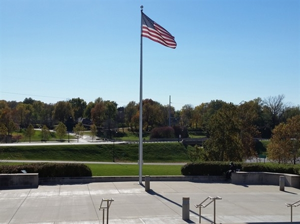American flag flying in front of the Harry S.Truman Library and Museum