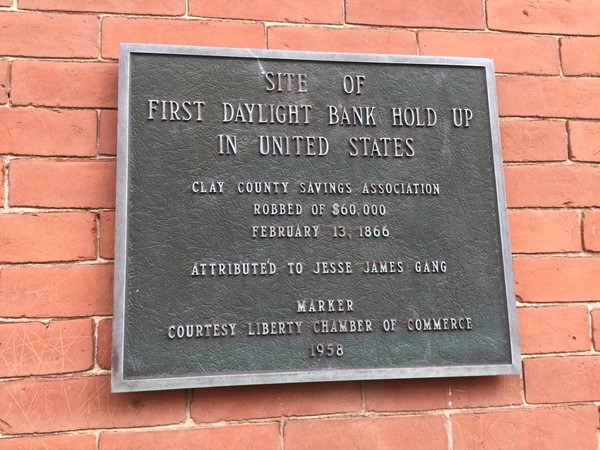 Historic marker for the first daylight bank robbery in Liberty