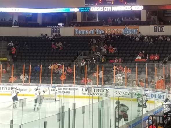 Hanging banners at the Independence Events Center