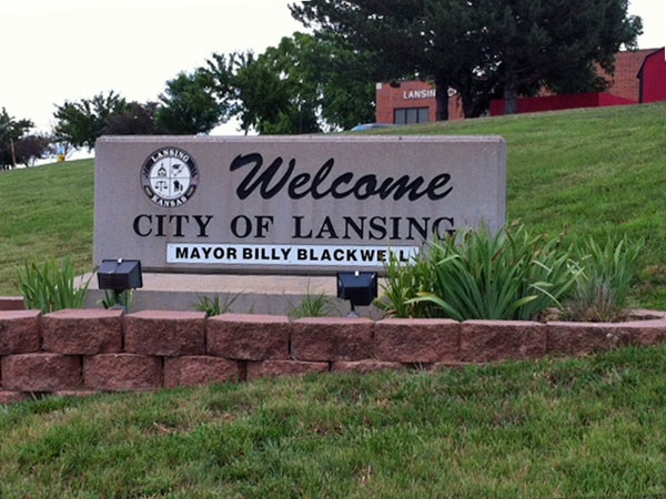 Welcome to Lansing, sign at City Hall,