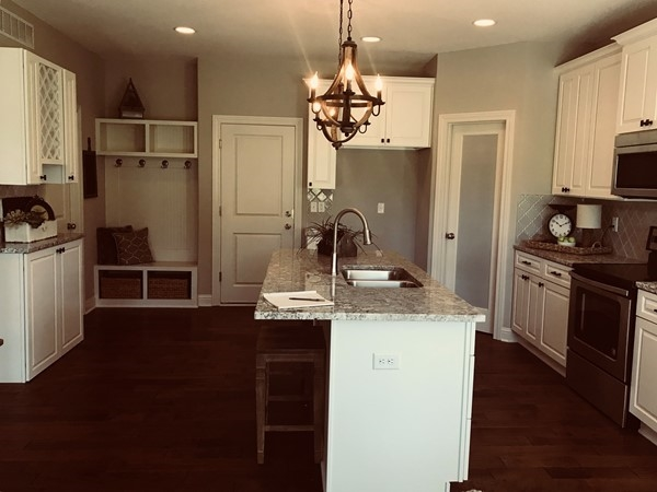Open concept kitchen in the Linden plan at NewBerry at Piper