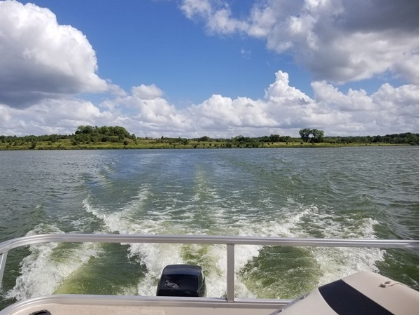 Life is always a little bit better on a boat at Creekmoor Subdivision, in Raymore