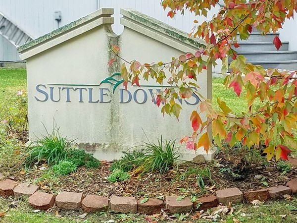 A monument sign for Suttle Downs on West 75th Street in Shawnee