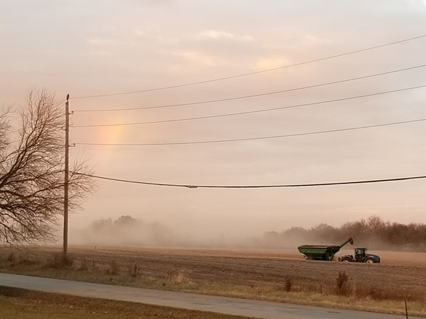 A rainbow during the harvest, just outside of Ward Park Place, in Raymore