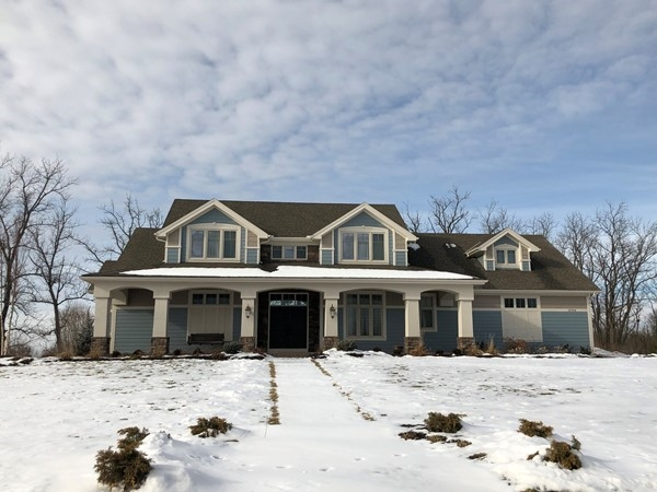 Love this home!  Gorgeous front entrance with lake access in back