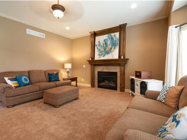 A staged living room by Staging Dreams at Eagle Creek Subdivision, in Lee's Summit