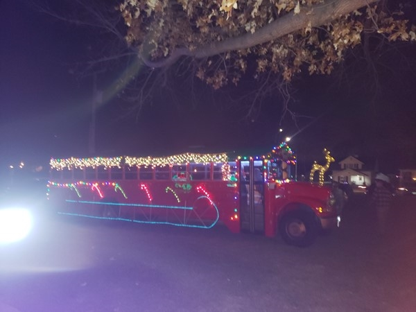 Santa bus goes from neighborhood to neighborhood visiting kids