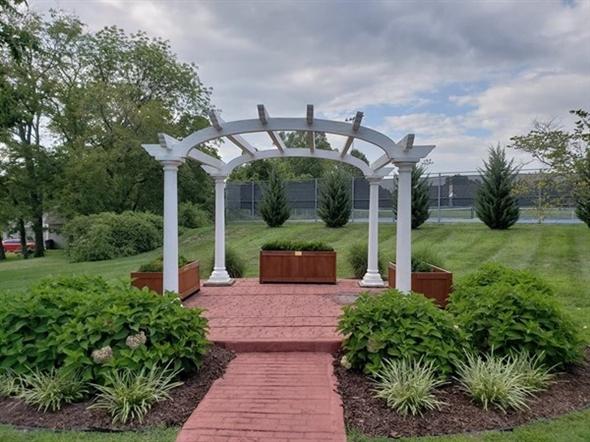 The arbor at Lake Lotawana Memorial Garden is perfect for weddings