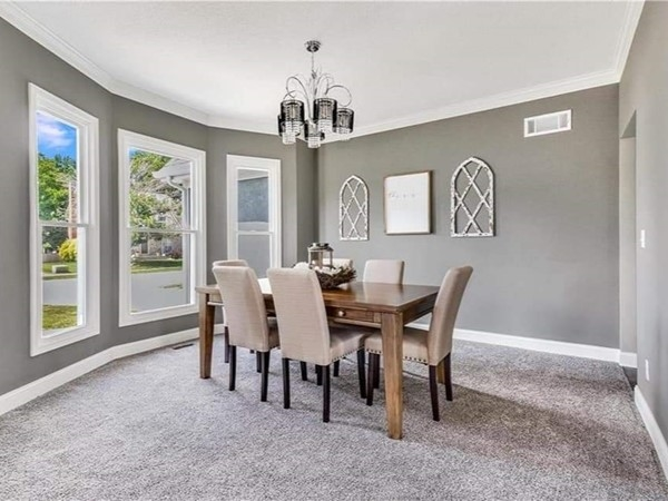 A beautifully staged dining area at Lakewood Subdivision. Staged by Staging Dreams