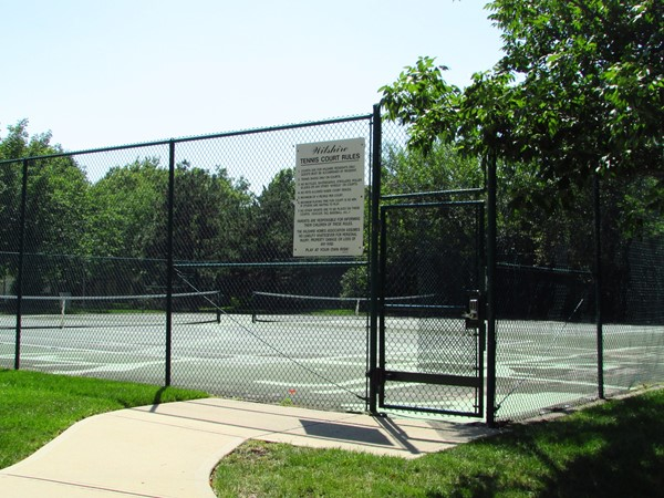 Tennis courts adjoin the pool area