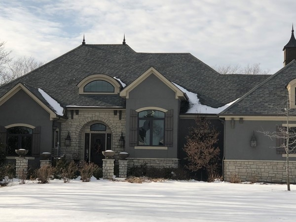 Love the stone and stucco combo on this Manderlay beauty