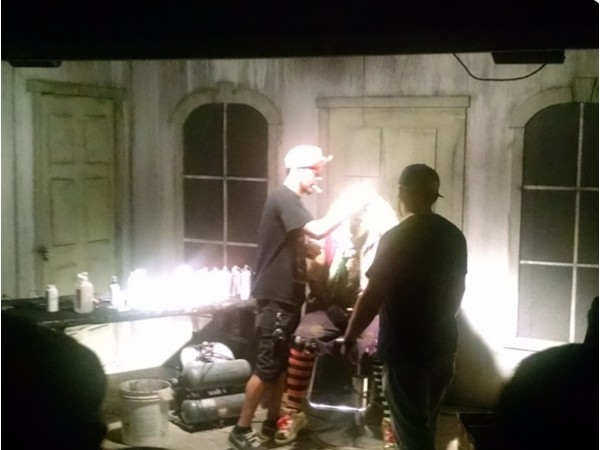 Damien Zimmerman Face-Off contestant prepping an actor - Zombie Toxin Haunted House