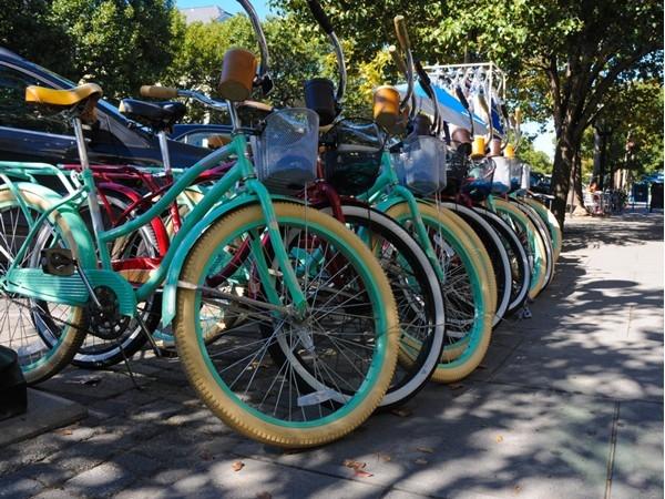 Colorful bikes line the sidewalk in Ocean Grove
