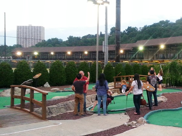 Family fun with a game of miniature golf at the Edgewater Golf Range. So much to do right in town
