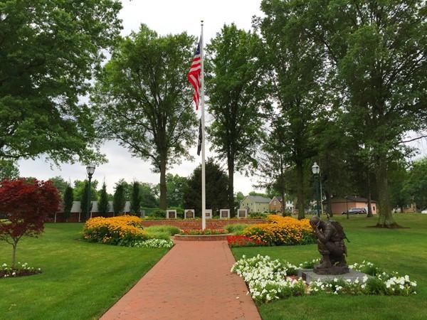 Veterans Memorial Park in Berkeley Heights. Kneeling Soldier Statue by Remembrance Circle