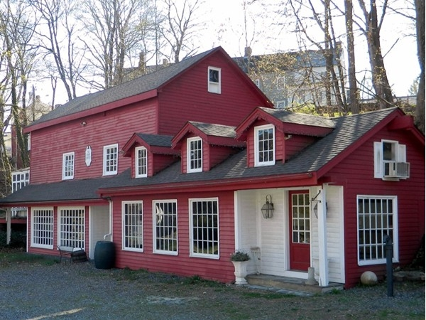An old carriage house converted into a shop at one time
