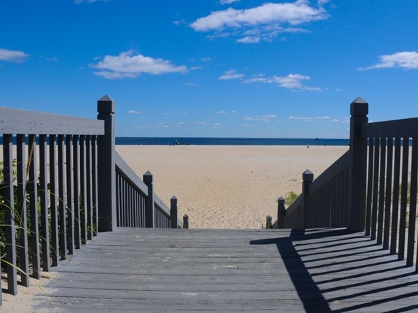 Steps lead to a picturesque beach in Sandy Hook