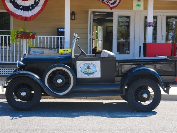 An old-fashioned car sits outside the Tuckerton Seaport Museum