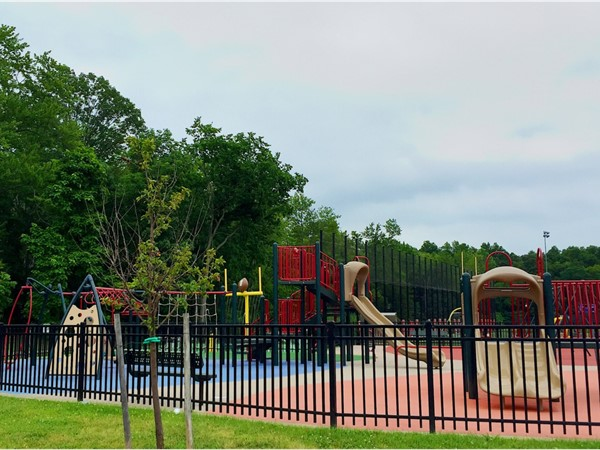 Snyder Park - Fenced in playground, plus Splash Park, with fields in the background