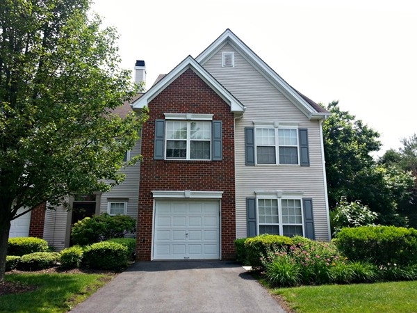 An end-unit townhouse in Princeton Crossing with a 2-story family room and a 1 car garage