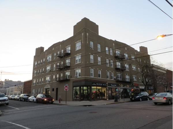 Apartment building with great Mom and Pop shops - Support Small Business