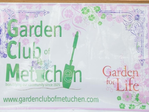 Members of the Garden Club of Metuchen keep our Main Street flower pots filled