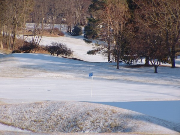 Winter flag at first hole Lake Mohawk Golf Course waving at spring