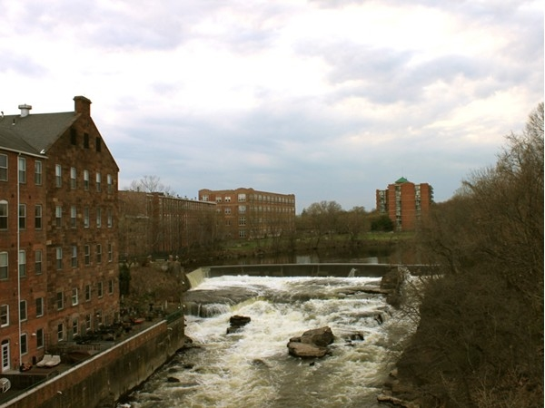 A view of the 11+ acres and waterfalls of The Mill condo complex in Little Falls