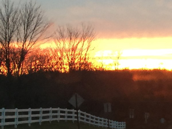 Gorgeous country road sunset over Windy Brow Manor in Fredon! Come visit one of the prettiest towns