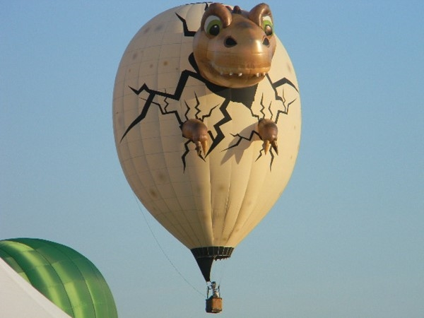 The baby dinosaur was even at the balloon festival held at the Solberg Airport