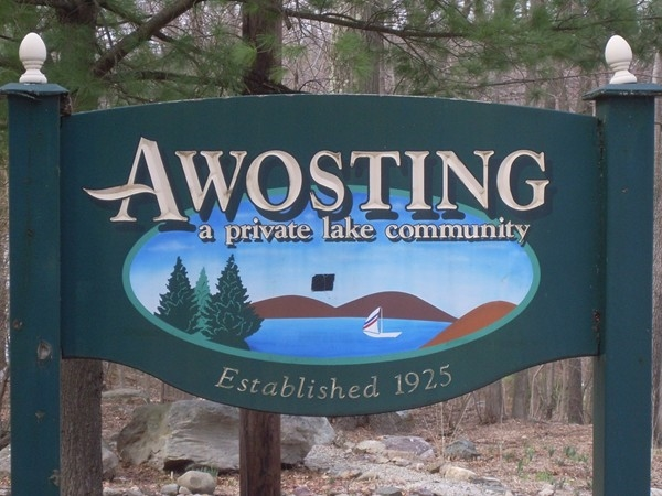 Awosting sign at main entrance, greeting visitors & residents