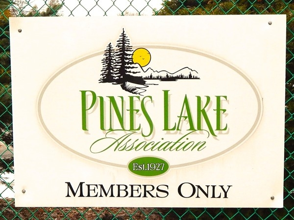 At the entrance of Pines Lake section in Wayne