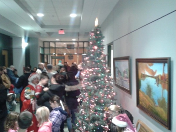 Holiday Tree Lighting in Milltown. Keeping warm inside Borough Hall