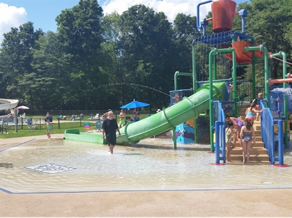The Pleasant Valley Pool features water slides, a jungle gym in shallow water, and more