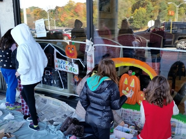 Verona students display their Halloween window painting skills at various Verona businesses
