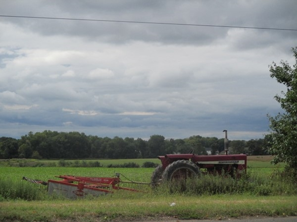 Love the open sky looming over this farm and old tractor. So peaceful