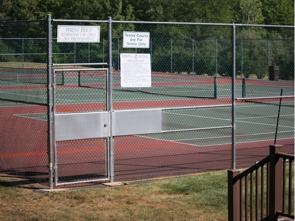 One of the two tennis court areas in Spring Ridge Development