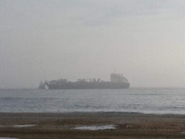 A foggy Sunday morning brings another shipload of sand to the beach