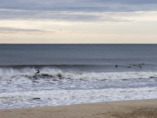 West End Beach is a popular spot for surfers to ride some waves