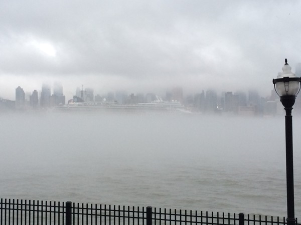 Watching a cruise ship depart on a fog-covered Hudson from Henely on the Hudson in Weehawken