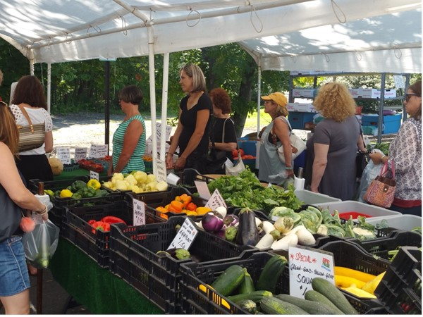 Residents enjoy shopping for a variety of fresh seasonal produce every Sunday during summer.