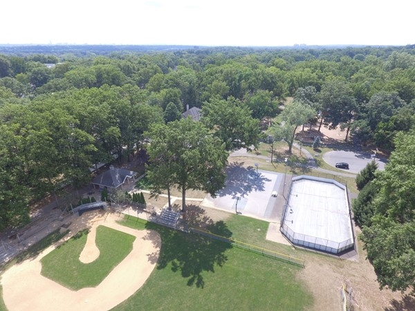 Aerial of Memorial Park in River Edge with| baseball field, street hockey rink, and basketball court