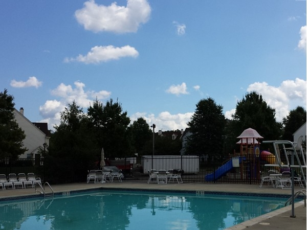 Pool and playground area of Nassau Square townhome community
