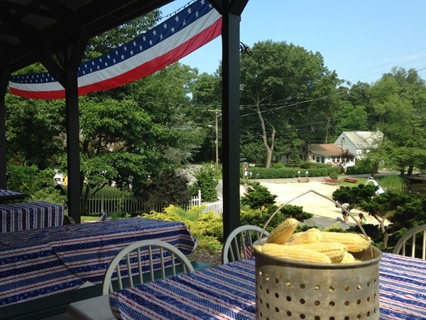 Tables and yummy Jersey corn await guests on Family Day, beach and lake in the background