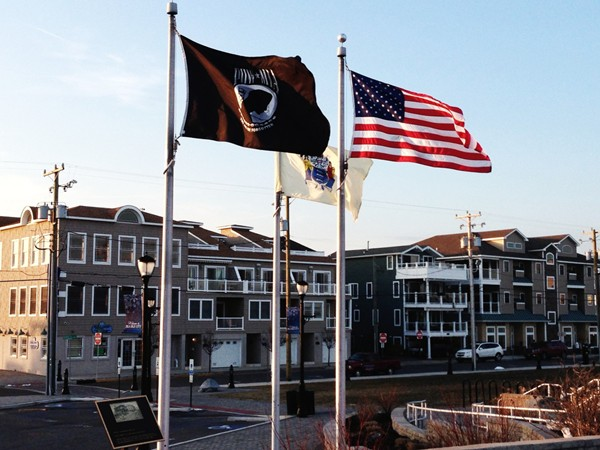 US, State of New Jersey, and POW-MIA flags near Excursion Park