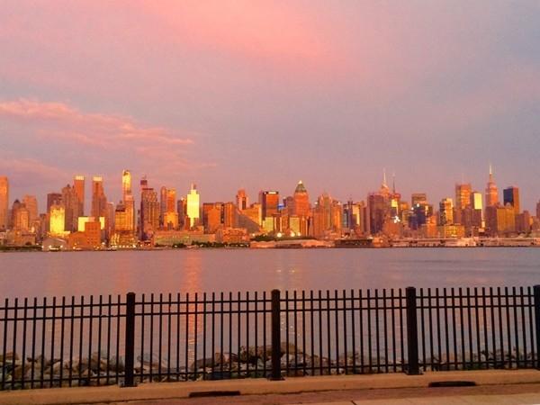 Summer sunset lights up the New York City skyline