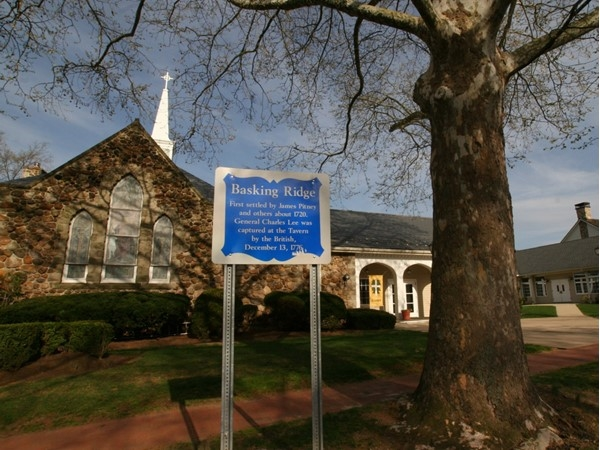 Historical signs like this one on the background of Basking Ridge can be found throughout town