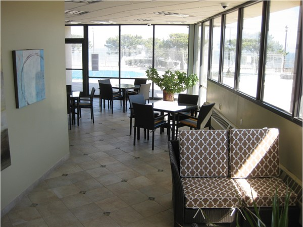 The community room at Ocean Plaza leads out to the pool and the beach in Long Branch