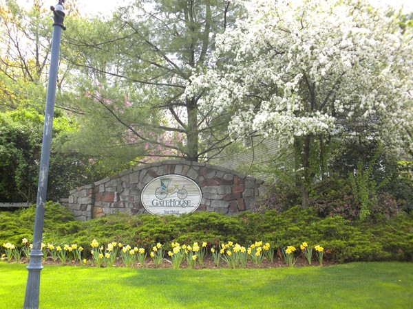 Gatehouse Development entry with pretty spring foliage